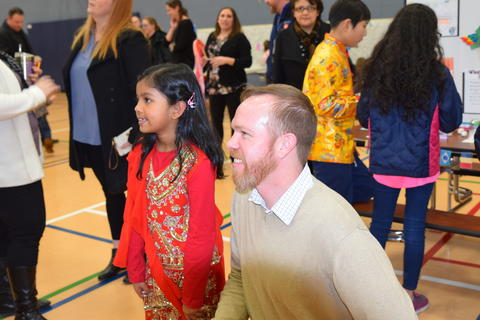 male teacher and young girl smiling