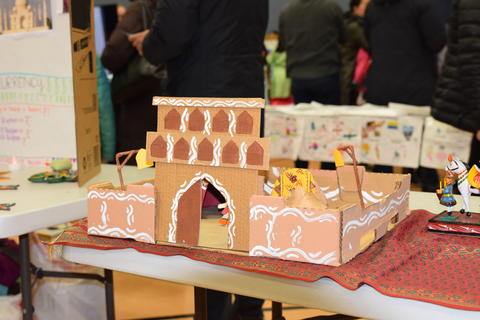 small cardboard building displayed on table