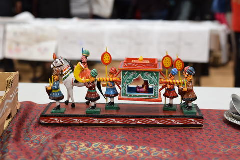 Painted wood decoration of people and horse