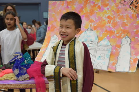 young smiling boy posing in cultural robe