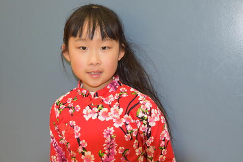 young girl in cultural dress smiling