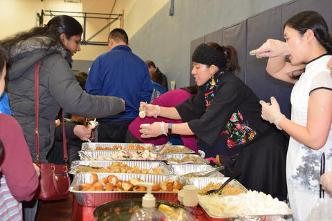 woman in cultural dress serving food