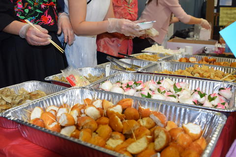 Chinese foods in foil serving pans