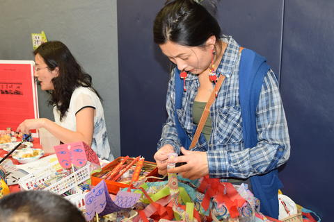 women at craft booth