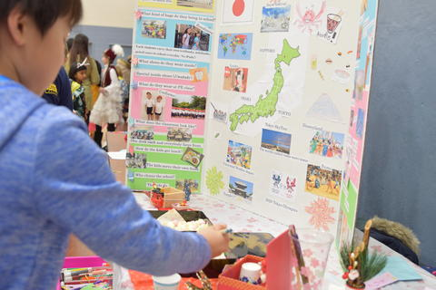 boy looking at Japan trifold project board