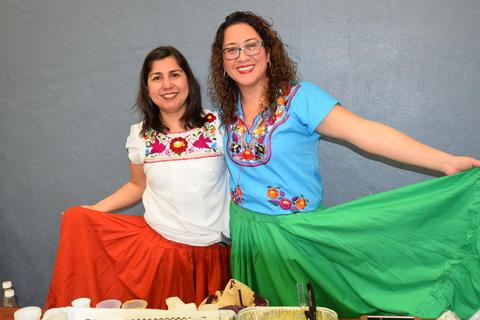 smiling women holding full skirts