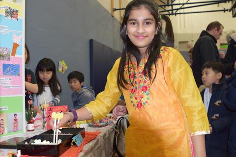 smiling girl using chopsticks