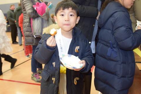smiling boy sampling food