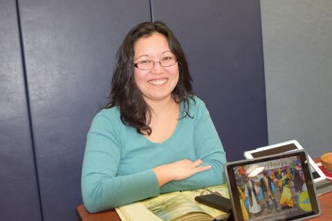 smiling woman with iPad computer display