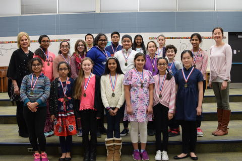 middle school boys and girls with medals posing in group