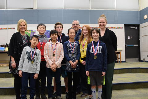 students with medals and teachers posing