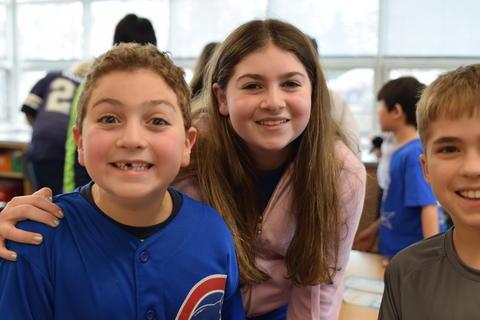 young boy and girl smiling at camera