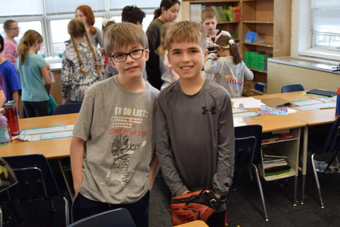 two young boys smiling at camera