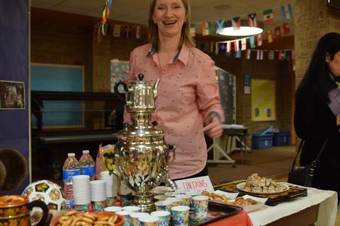Smiling woman with samovar