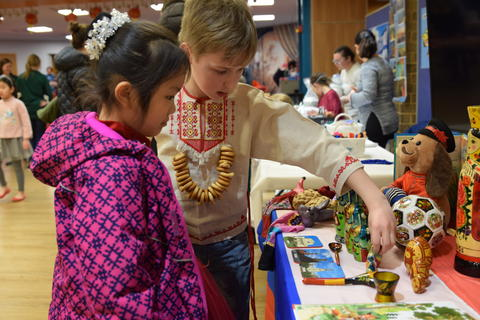 Young boy and girl examining cultural tabletop display
