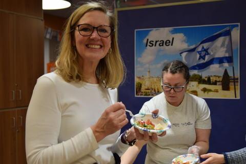 Smiling woman sampling food