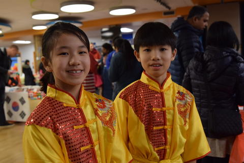 two smiling young boys wearing cultural clothing