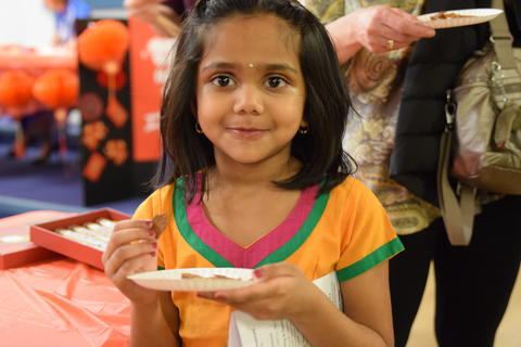 smiling girl holding small paper plate