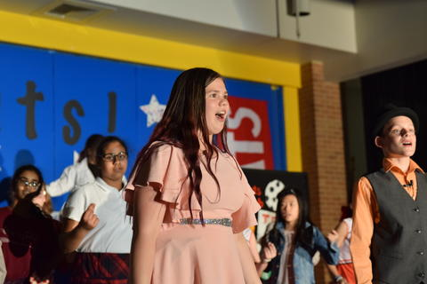 Young girl onstage singing