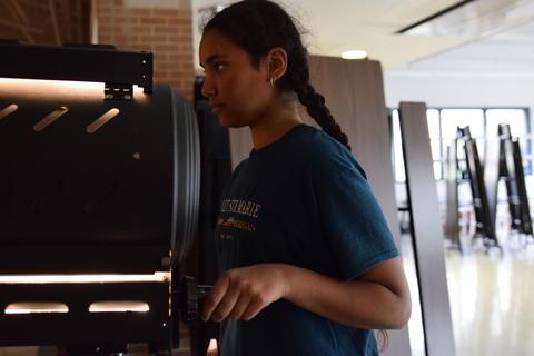young girl operating spotlight