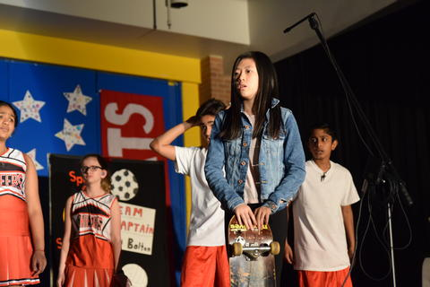 young performers onstage talking