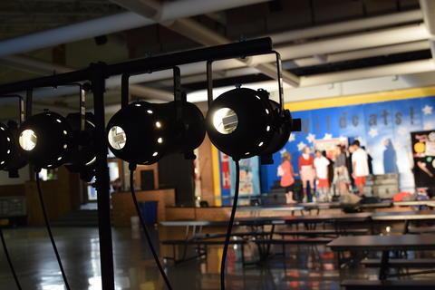 spotlight equipment aimed at stage