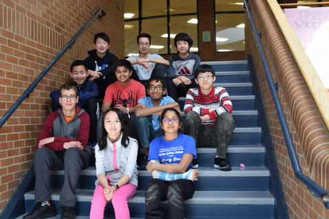 middle school students posing for student recognition photo
