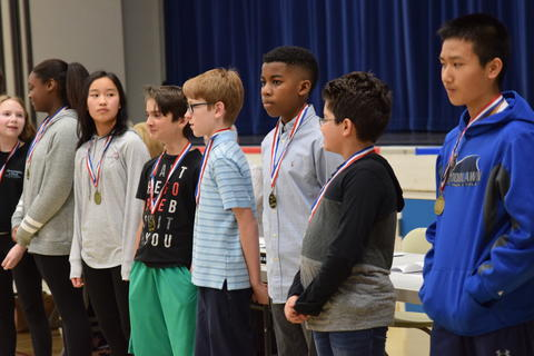 middle school students with recognition medals