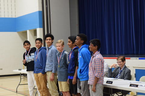 middle school boys posing for student recognition photo
