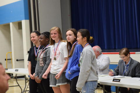 middle school girls posing for student recognition photo
