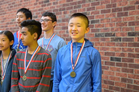 smiling middle school boys wearing recognition medals