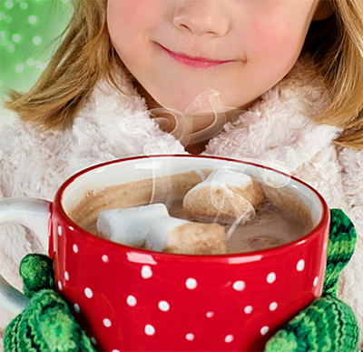 smiling young girl holding cup with cocoa and marshmallows
