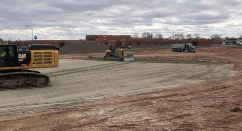 The project site has been stripped of all it's top soil.  With the top soil gone, structural fill material is being trucked to the site to build up the building pad for the school.