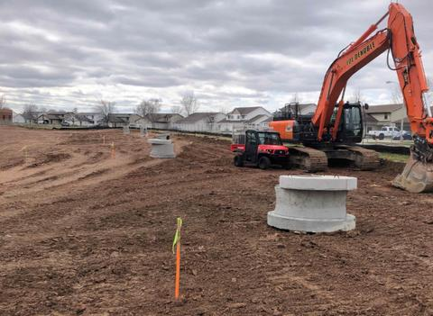 The material for the site utilities has been delivered to the site.  Pictured above are the staked out locations of the storm water inlets for the future 9th Street parking lot.