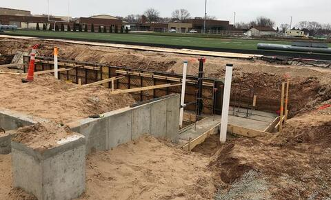 Over by the stadium, crews continue with wall pours on the South Restroom Building, and will follow with the North Restroom Building. Once complete, Gauthier will begin backfilling so masonry can start.