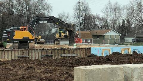 Gauthier continues to backfill the walls on the Classroom Addition. They are also finishing up the detention pond, and site utilities are being installed near the new South Parking Lot.