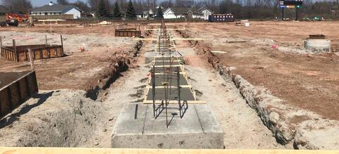 The concrete column pads and footings have been formed and poured along the east wall of area A.  In the next few weeks, the foundation walls will be poured on top of these footings.