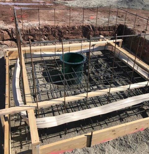 Pictured above is the elevator pit earlier this week with the sump pit, waterstop, and rebar in place and ready to be poured.