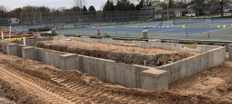 Concrete walls are complete on the North Restroom Building, with slab-on-grade pour to come next week. The relocation of the athletic light poles will also take place soon. On the east side of the Stadium, site utilities will wrap up next week so the retaining wall installation can begin.