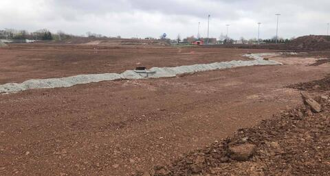 With the storm sewer in place, the east parking lot is being cut and graded before the stone is placed on top.  Stone should start going down here next week so this area can be used as a construction laydown area.