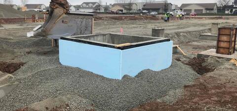 The elevator pit and walls are in place.  Waterproofing was installed over the concrete walls below the foam insulation.