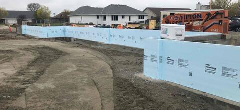 The foundation walls have been poured on the north side of area A and covered with foam insulation.  The next step will be to backfill these walls with structural fill.