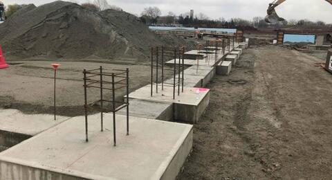 Concrete footings are in place on the south side of the courtyard.