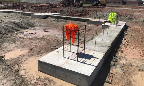 The concrete footing in area B have started.  This footing pictured above will provide the foundation for the front corner of the library.