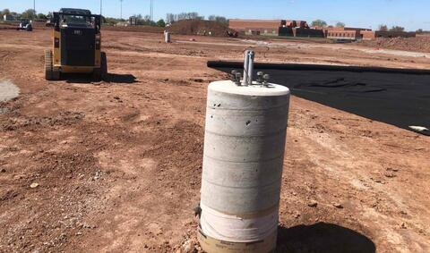 The light pole bases have been installed in and around the east parking lot.