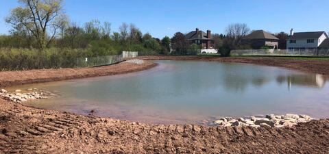 With rain over the weekend and early in the week, the retention pond has really come in handy.  This allowed us to pump water into the newly installed storm sewers and run it here.