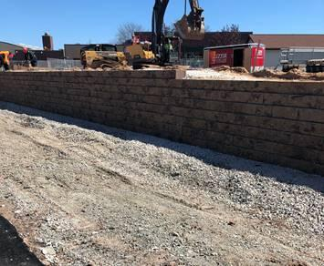 Retaining wall near completion and site concrete will begin next week on the east side of the stadium. Once site concrete is complete  then the bleacher reinstallation will begin.