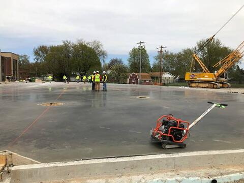 Slab on grade was completed on Tuesday for the classroom addition and steel is starting to show up on site.