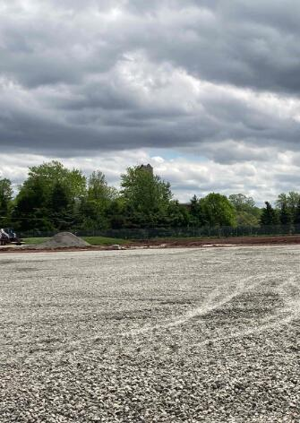 The large east parking lot has been graded and stoned. This parking lot will serve as laydown area for the structural steel.