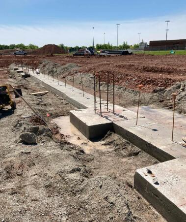 Continuous footings and column pads are being poured into Area C, and foundation walls will soon follow.